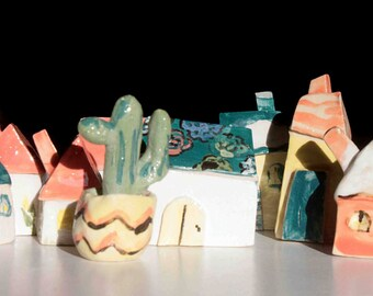 Handmade ceramical nice little houses to decorate any shelf and any kind of interior.