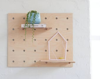 Twiggargerie Wall House with Bird