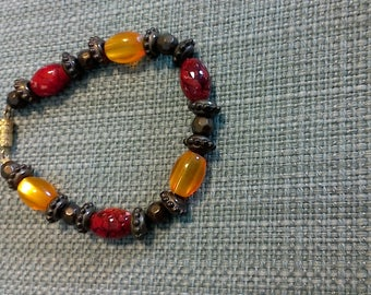 Bronze, gold and red beaded bracelet
