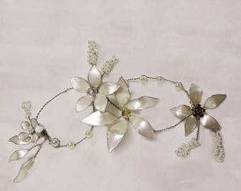 Wire, glass and enamel flowers. Touched only