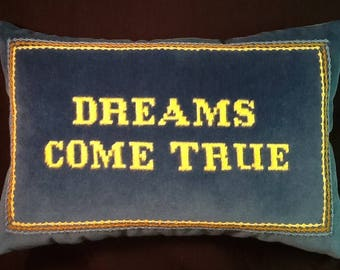 """A hand-embroidered pillow """"Dreams Come True"""""""