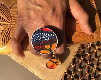 "Ring in wood and African cloth ""Wax Loop"", model ""African Sunset"". ""African Sunset"", african fabric covered wooden rings, ""Wax Loop""."