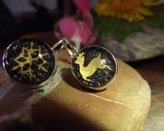 Black etched brass reindeer and snowflake Christmas earrings