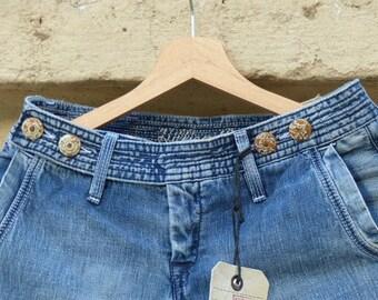 Hilfiger Vintage Clothing. 1980s flared jeans. Hippie bell bottom pants. Wanderlust trend.