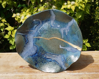 Large handmade turquoise, blue and gold ceramic plate.