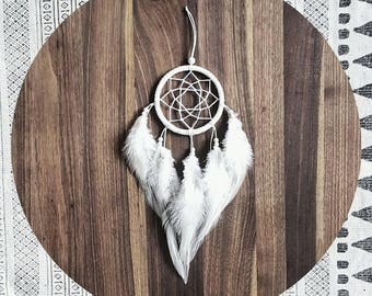 White simple dreamcatcher made from organic materials and perfect white feathers - suitable for crib, car, gift and the kids room