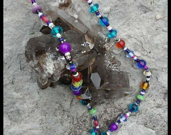 Quartz crystal pendant and Glass bead necklace