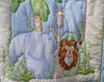 Flannel baby quilt. Elephant, giraffe, lion 36x45 panel. Green picot binding 100% polyester batt. Give a cute gift of love to the new baby.