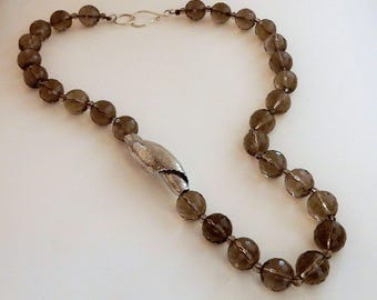 Smoky quartz necklace with a large twisted silver bead