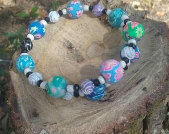 Boho hippy bracelet.  Polymer clay and glass beads. 8 inch. Memory wire.