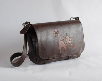 Brown leather messenger bag with cat