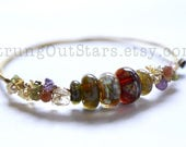 Tapestry - Strung-Out guitar string bangle with artisan glass and gemstones
