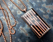 copper brads rectangle necklace in black