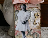 XOXO Tag with silver German scrap wings