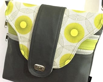 Cross body zipper vegan bag in yellow and grey.