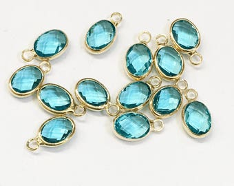 6 pcs of  Glass faceted oval with  brass setting 12x7mm zircon blue ,  glass charm, bulk glass charm