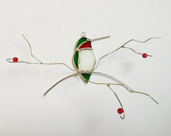 Bright green with red throat Ruby Throated Hummingbird frontal view stained glass suncatcher on wire branch.