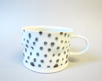 Spotted porcelain cup