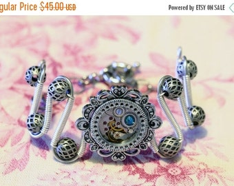 HAPPY HOLIDAYS SALE - Steampunk Jewelry - Bracelet - antique watch movement and dark aqua swarovski crystal - Silver tone