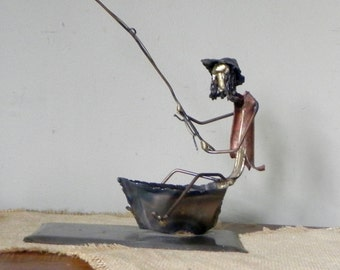 Vintage mid century modern sculpture fishing man brutalist in the style of c jere