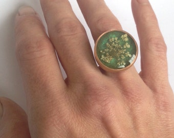 Copper statement ring  with embedded flower