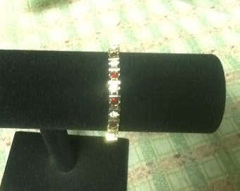 Red and white rhinestone bracelet