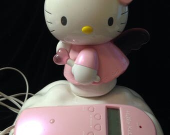 HELLO KITTY TELEPHONE with caller id pink and white with matching cords