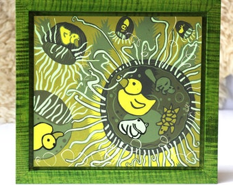 Jellyfish and Rubber Duck woodcut framed in solid tiger maple wood allow 4 weeks for delivery