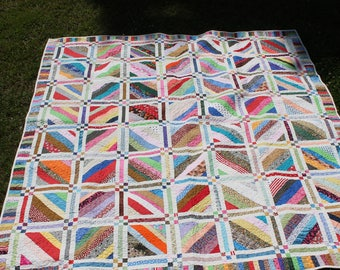 Patchwork multi color string quilt. Bed Size