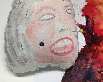 Theresa May playful revenge voodoo pin cushion politics geekery