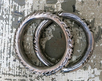 A Pair of Silver Stamped Metal Bangle Bracelets