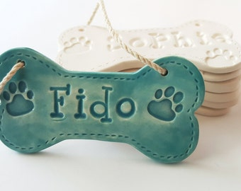 Dog Bone Christmas Ornament with Name and Paw Print Personalized Dog Ornament Clay Custom Made to Order Personalized Ceramic Dog Bone