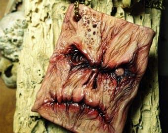 Necronomicon ex Mortis pendant sculpture clay
