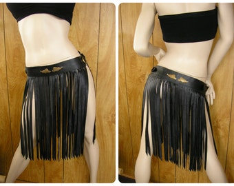 "Black leather fringed belt, long fringe with brass wings, fringe is 1/4"" wide, length is 20 1/2"", buckles on each side, size is 31.5 to 35"
