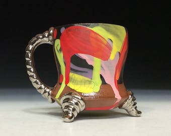 Colorful cup with white gold handle and feet