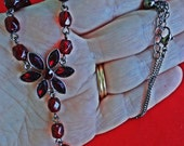 """Vintage unsigned AVON 18"""" silver tone necklace w dark red beads and rhinestones  in great condition, appears unworn, 2"""" center darpe"""