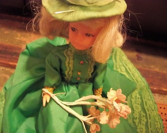beautiful doll in clover green handmade dress and hat