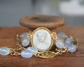 Reserved for H...Antique Assemblage Necklace with Grey Lava Cameo, Holly Blue Chalcedony and Antique Filigree Chain