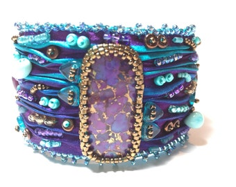 Shibori bead embroidered cuff bracelet with mohave purple focal
