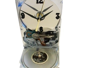 Computer Hard Drive Clock has Silver Finish with Circuit Board and Spindle Accent, unique Electronic Gadget.