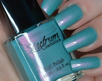 SIRENS SONG Shimmery teal nail polish with Pink iridescence