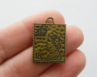 6 Postage stamp charms antique bronze tone BC124