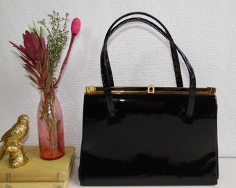 Vintage Black Patent Kelly Bag with Brown Suede Lining, Top Handle and Gold Clasp Frame.