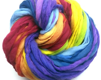 Super bulky handspun rainbow yarn, 65 yards and 3.5 ounces/ 100 grams, spun thick and thin in self striping merino wool