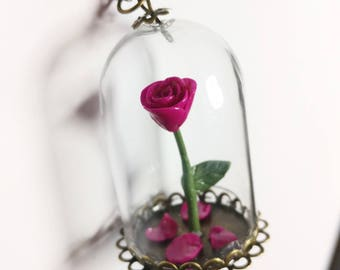 Magenta enchanted rose necklace. Cloche glass. Beaty and the beast inspired.