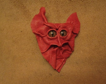 Grichels leather pin/tie tack/brooch - raspberry with bronze speckled slit pupil reptile eyes