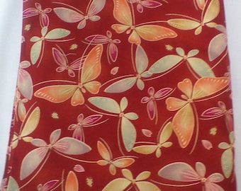 Rust colored butterfly cotton fabric