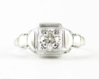 Art Deco Filigree Engagement Ring, 18ct White Gold Single Stone 0.15 ct Round Brilliant Cut Diamond Ring. Circa 1930s.