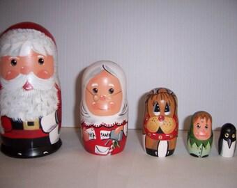 Hand painted Santa Family stacking nesting doll set