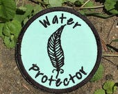 "DONATION PIECE, ""Water Protector"", handmade iron on patch, Standing Rock Sioux Tribe, feather, resist, resistance, free shipping, upcycled"